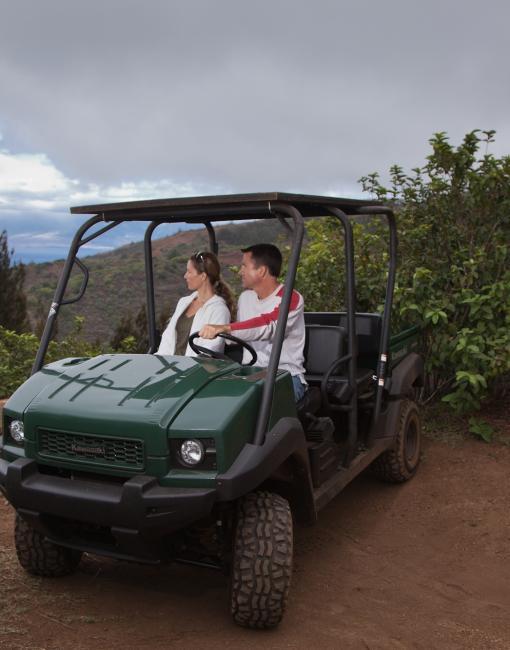 A couple driving a jeep on Lanai