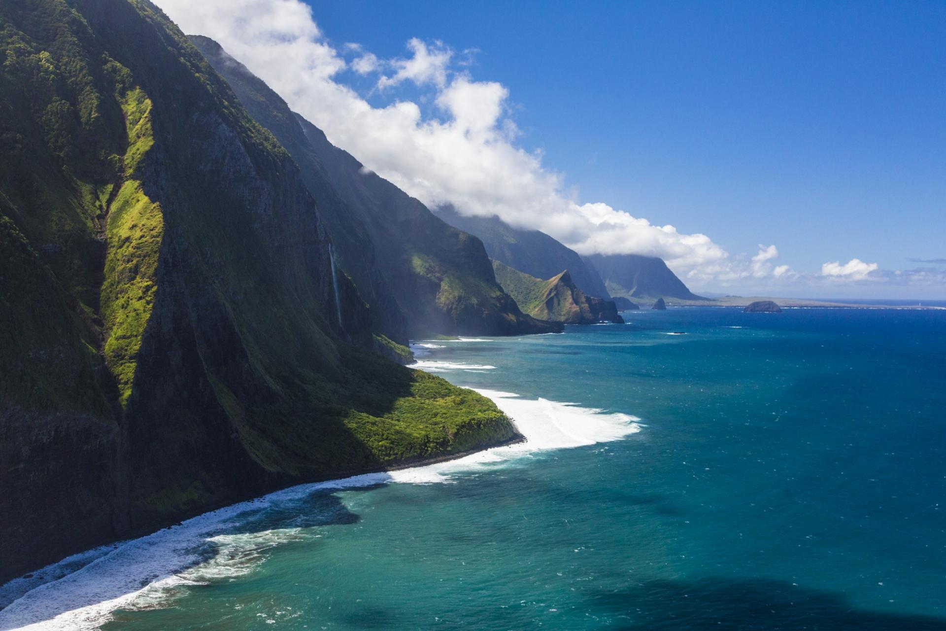 The green sea cliffs on the coast of Molokai