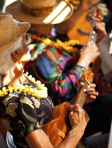 People playing ukuleles at a Molokai event