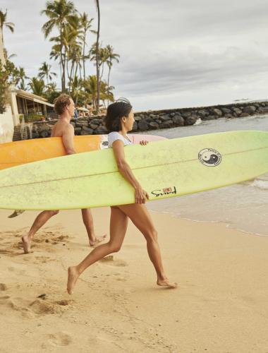 Surfers on an Oahu beach