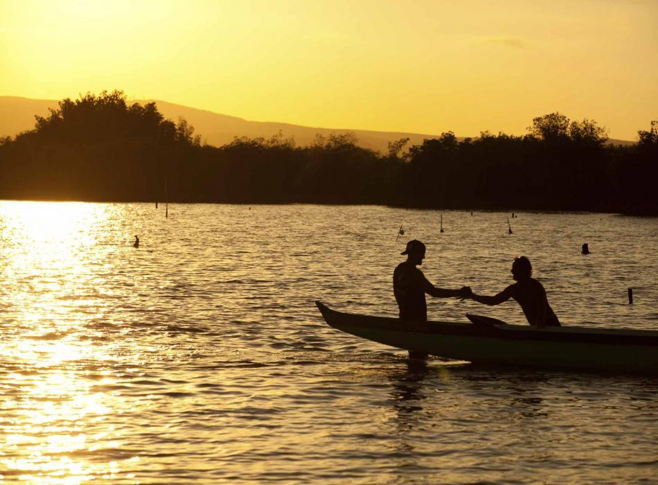 Kayaking at sunset off the coast of Molokai