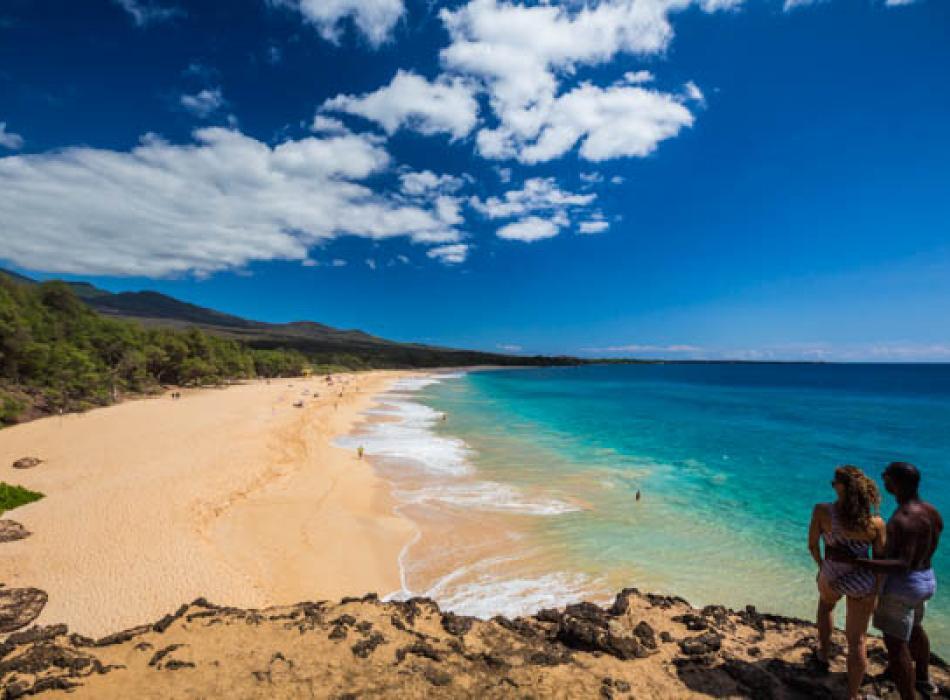 A couple enjoying the view on a beach on Maui